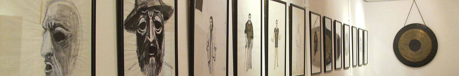 Framed costume design sketches hanging on a wall at the APGRD's Oresteia Exhibition, 2011