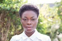 Portrait photograph of Joan Iyiola, by Lucy Barriball